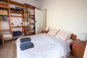 A bed or beds in a room at House near the Athens Airport, Spata.
