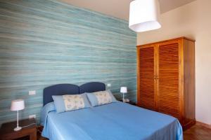 Letto o letti in una camera di FAVIGNANA HOTEL Concept Holiday