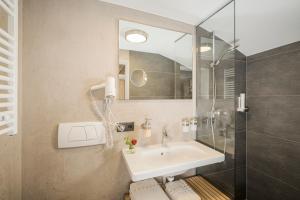 Ein Badezimmer in der Unterkunft Gästehaus die geislerin