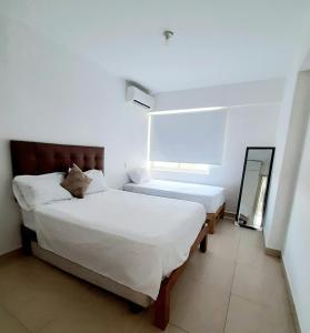 A bed or beds in a room at Apartamento en Country Club Miraflores PIURA