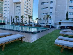 The swimming pool at or near Olympic Residence Deluxe Apartments