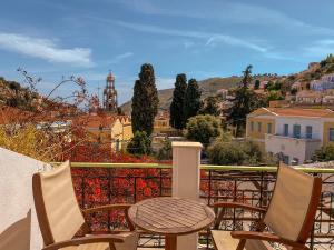 A balcony or terrace at Symi Garden Studios