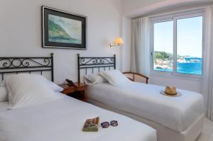 Een bed of bedden in een kamer bij Hotel Costa Brava