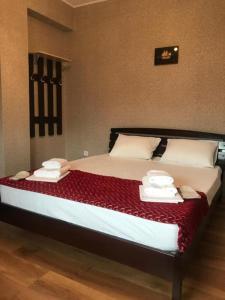 Кровать или кровати в номере Связь Времён Гостевой Дом