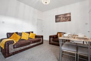 A seating area at Staywhenever LS- 4 Bedroom House, King Size Beds, Sleeps 9