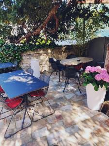 A patio or other outdoor area at La Maison Grivolas