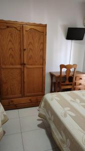 A bed or beds in a room at Cafetería HOSTAL GALICIA