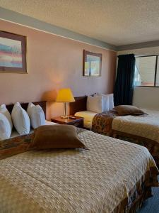 A bed or beds in a room at Value Lodge Inn
