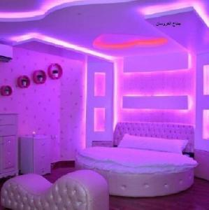 Cama ou camas em um quarto em Rokn Alyaqut Furnished Apartments