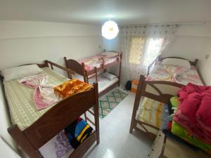 A bunk bed or bunk beds in a room at Vlora Backpackers Hostel