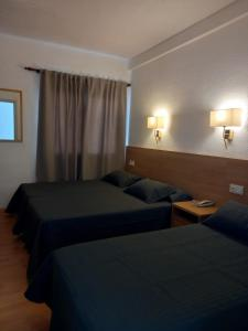 A bed or beds in a room at Hotel Internacional