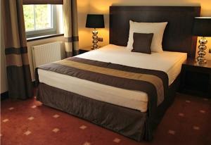 Łóżko lub łóżka w pokoju w obiekcie Spa Medical Dwór Elizy
