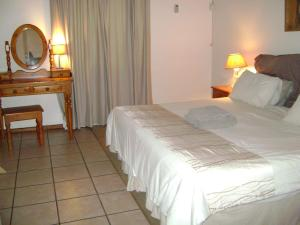 A bed or beds in a room at Orchards Farm Cottages