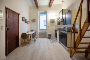 A kitchen or kitchenette at Beautiful studio mezzanine near Vieux Port