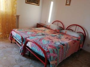 A bed or beds in a room at Casa Santinelli