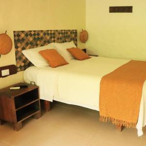 A bed or beds in a room at Pousada Dos Artistas