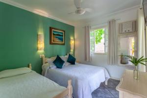 Cama ou camas em um quarto em Pousada Casablanca