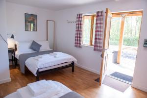A bed or beds in a room at Cowbridge Cabins