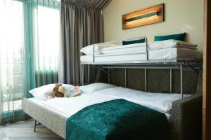 A bunk bed or bunk beds in a room at Best Western Plus Hotel Erb