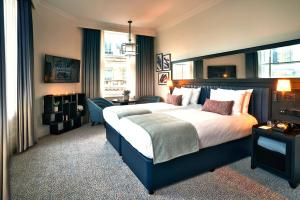 A bed or beds in a room at The Grand Hotel Birmingham