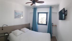 Un ou plusieurs lits dans un hébergement de l'établissement Hôtel Atlantica Bordeaux Métropole