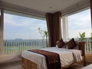 Giường trong phòng chung tại Minh Manh Hotel 2