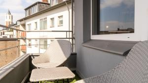 A balcony or terrace at Ginius Homes: Oriental city room