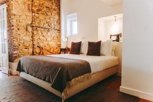 Uma cama ou camas num quarto em 54 Santa Catarina Apartments