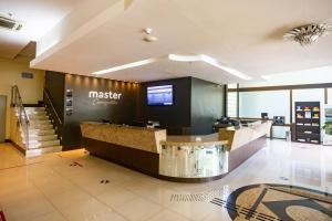 The lobby or reception area at Master Cosmopolitan Moinhos de Vento