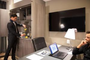 A television and/or entertainment center at Krystal Grand Suites Insurgentes