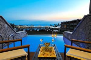 The swimming pool at or near Kandia's Castle Resort & Thalasso Nafplio