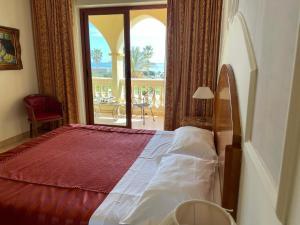 Letto o letti in una camera di Parco dei Principi Hotel