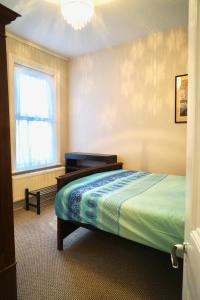 A bed or beds in a room at Tottenham Stadium double room