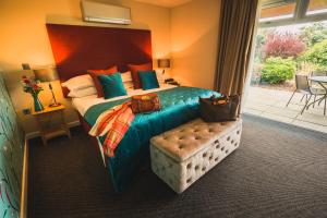A bed or beds in a room at Lanhydrock Hotel & Golf Club