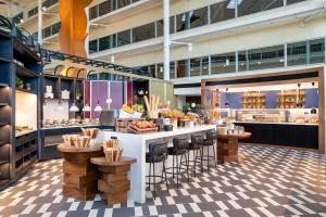 A restaurant or other place to eat at Hilton London Heathrow Airport