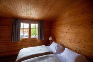 A bed or beds in a room at Vogafjós Farm Resort