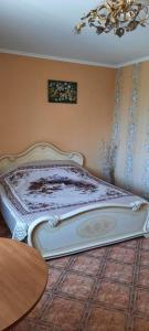 Кровать или кровати в номере Guest House on Pobedy 7A