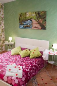 A bed or beds in a room at B&B Casa Tancredi