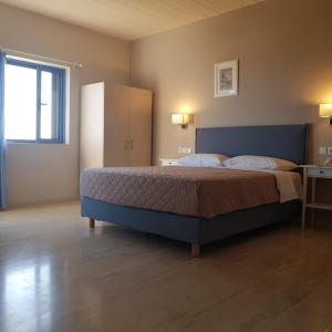 A bed or beds in a room at Sirene Villas
