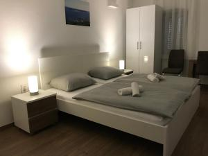 A bed or beds in a room at Barba Ante