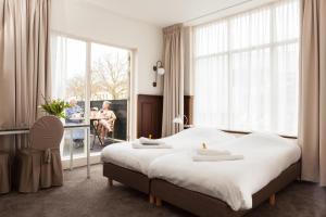 Cama o camas de una habitación en Hotel Stad en Land