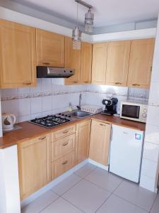 Kuchnia lub aneks kuchenny w obiekcie Warsaw Center - Apartment near Central Railway Station