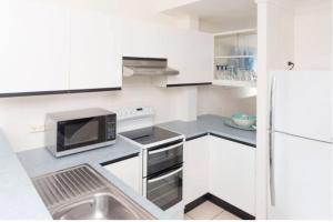 A kitchen or kitchenette at mango tree private townhouse