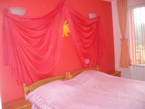 A bed or beds in a room at Sveti Georgi Guest House
