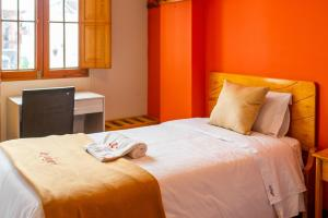A bed or beds in a room at Le Foyer Arequipa