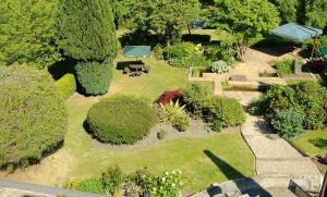 A garden outside The Parklands Hotel