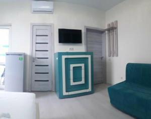 Телевизор и/или развлекательный центр в Гостевой Двор «Море Удачи»