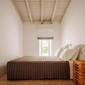 Uma cama ou camas num quarto em Companhia das Culturas - Ecodesign & Spa Hotel