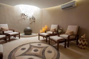 A seating area at Mahekal Beach Front Resort & Spa