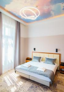 A bed or beds in a room at Sky Hotel Krakow